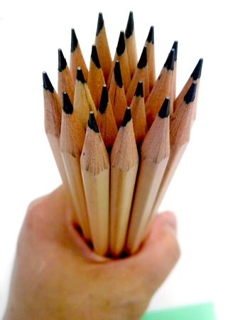transcribe: Pencils  in hand  on white  background Stock Photo