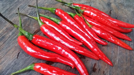 Red chilli  on  wooden  floor