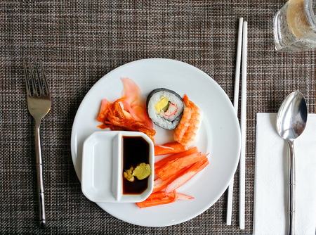 Sushi set  in white dish on wooden plate mat Stock Photo