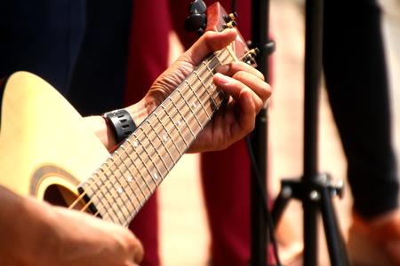 Image of playing guitar
