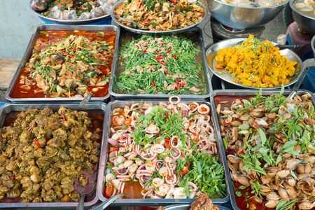 Oriental food - Thai takeaway at a Chiang mai gate market. photo