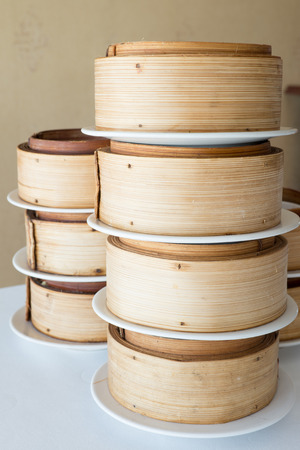 A pile of bamboo steamer set.