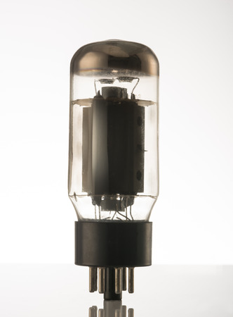 Old vacuum tube isolated on wite baclground. photo