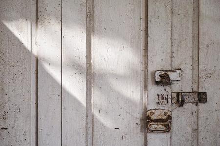 Old wooden door with shadow