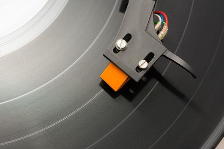 Cartridge moving on black vinyl.