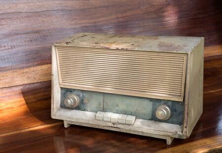 Vintage radio on wooded background.