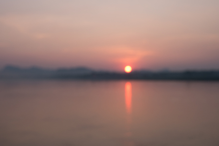 Blur background of sunset on river bank