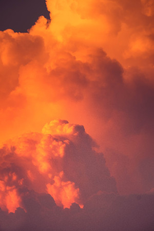 CUMULONIMBUS cloud in sunset background for forecast and meteorology concept