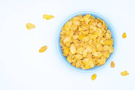 Top view of cereal Grains in yellow cereal in a blue plate