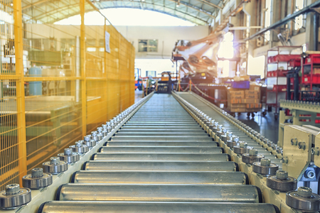 Automatic robotic warehouse with roller conveyor in industrial factory Editorial
