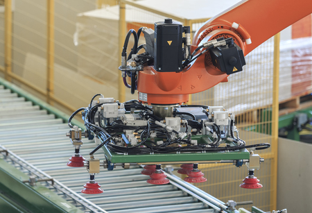 Factory  concept.Industrial picking robot in smart warehouse system of manufacture factory Imagens