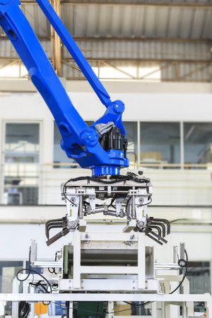 Factory concept.Industrial picking robot in smart warehouse system of manufacture factory