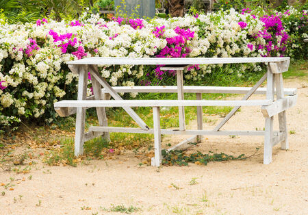lawn chair: White wooden table in a park Stock Photo
