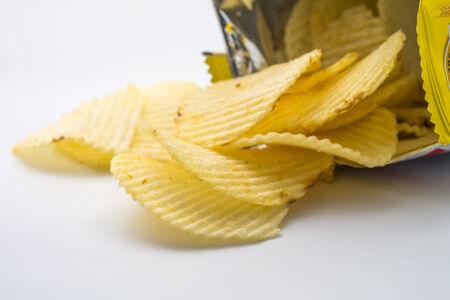 potato crisps: Group of potato chips in bag on white background Stock Photo