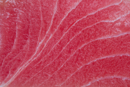 Close up view of a raw tuna steak.
