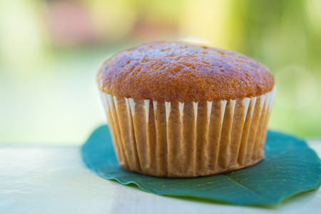 mini oven: Banana cup cake on the green leaf Stock Photo