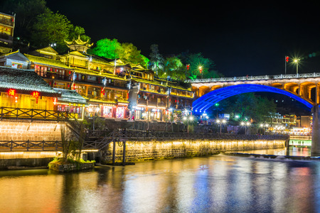 huang: Feng Huang at night, the most famous ancient town in Hunan province, China.