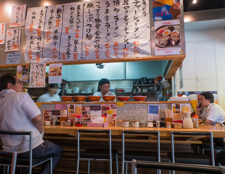 FUKUOKA, JAPAN - SEPTEMBER 26, 2014: Interior of Ramen  restaurant in Hakata, Fukuoka, Japan.
