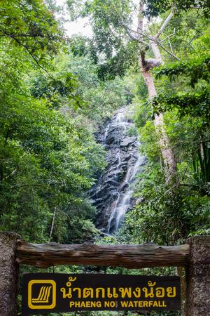 phangan: Wooden sign of Phaeng Noi waterfall in front of the water fall at Koh Phangan, Suratthani, Thailand