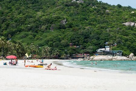 phangan: KOH PHANGAN,THAILAND - MAY 2, 2014: Haad Rin beach or the full moon party beach during day time many tourist coming to sun bathing and swimming. Editorial