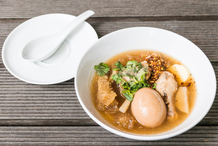 chinese food: Fish maw soup on wooden background Stock Photo