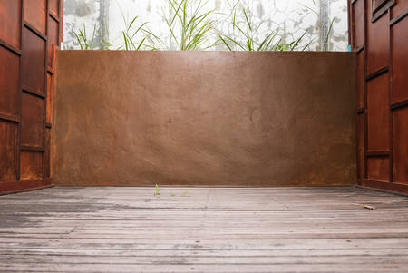 concrete construction: Vintage brown concrete textured wall with wooden floor