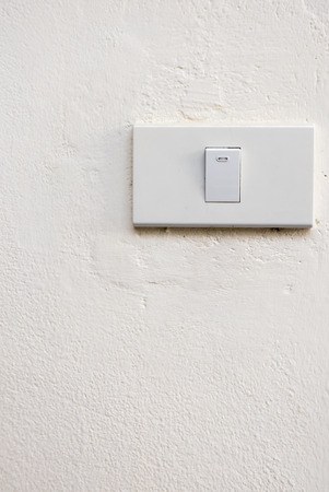 dimmer: Lightswitch on concrete wall