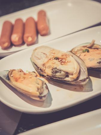 yakiniku: Raw Mussel with sauce and sesame for Yakiniku, vintage effect