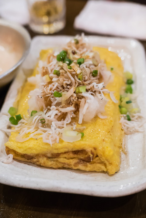 firmness: Typical traditional Japanese food - Omelet with white fish in Izakaya restaurant