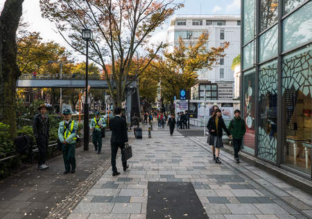 Harajuku: TOKYO JAPAN - NOVEMBER 30, 2015:  People walking in Harajuku. Harajuku is known as a center of Japanese youth culture and fashion and shopping. Editorial