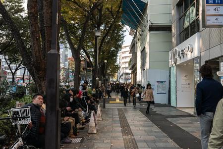 harajuku: TOKYO JAPAN - NOVEMBER 30, 2015:  People walking in Harajuku. Harajuku is known as a center of Japanese youth culture and fashion and shopping. Editorial
