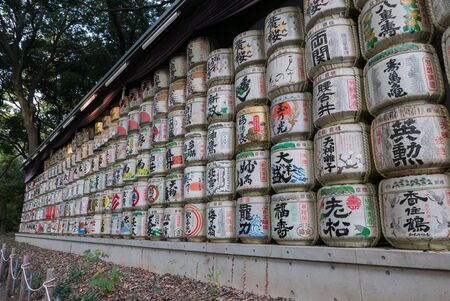 temple tank: Tokyo, Japan - November 30, 2015: Barrels of sake nihonshu donated to the Meiji Shrine in Tokyo, Japan. Editorial
