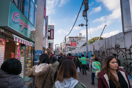 Harajuku: TOKYO, JAPAN - NOVEMBER 30,  2015: Takeshita Street is a pedestrian-only street lined with fashion boutiques, cafes and restaurants in Harajuku in Tokyo, Japan. Editorial