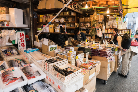 japanese ethnicity: Tokyo, Japan - November 30, 2015: A small area of Tsukiji fish market, The Tsukiji Market, supervised by the Tokyo Metropolitan Central Wholesale Market of the Tokyo Metropolitan Bureau of Industrial and Labor Affairs, is the biggest wholesale fish and se