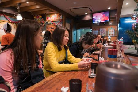 harajuku: Tokyo, Japan - November 30, 2015: Costomer waiting for Ramen in a Ramen restaurant in Harajuku, Tokyo. Editorial