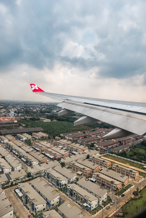 '5 december': Bangkok, Thailand - DECEMBER 5, 2015 Window of Airasia airplane in the afternoon landing at Donmuang airport, Bangkok, Thailand