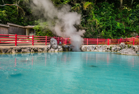 flashy: Kamado Jigoku or cooking pot hell in Beppu, Oita, Japan. Features several boiling ponds and a flashy demon statue as cook. On the grounds, visitors can drink the hot spring water, enjoy hand and foot baths, inhale the hot spring steam and try various snac Stock Photo
