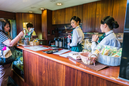 mori: Yufuin, Japan - September 28, 2014: Small cafe in the express train Yufuin no Mori. Yufuin no Mori (The Forest of Yufuin) are limited express train services operated by Kyushu Railway Company (JR Kyushu) which run from Hakata via Yufuin to Oita and Beppu.