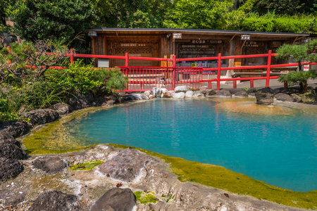 to inhale: Beppu, Japan - September 28, 2014: Kamado Jigoku or cooking pot hell in Beppu, Oita, Japan. Features several boiling ponds and a flashy demon statue as cook. On the grounds, visitors can drink the hot spring water, enjoy hand and foot baths, inhale the ho