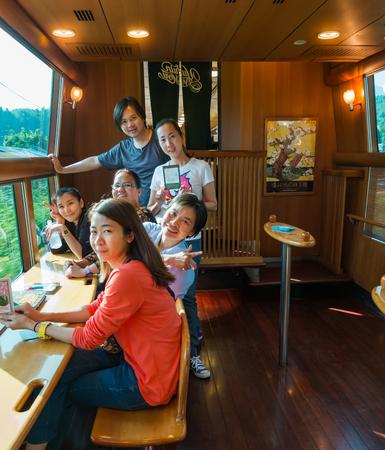 mori: Yufuin, Japan - September 28, 2014: Group of friends in the express train Yufuin no Mori. Yufuin no Mori (The Forest of Yufuin) are limited express train services operated by Kyushu Railway Company (JR Kyushu) which run from Hakata via Yufuin to Oita and