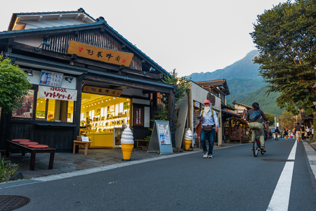 Yufuin, Japan - September 28, 2014: The main shopping street of Yufuin in Oita, Japan. Yufuin was a town located in Oita District, Oita Prefecture, Japan. Yufuin is now a district within the city of Yufu.