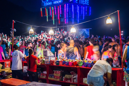 Koh Phangan, Thailand - October 8, 2014: The Full moon party at Haad Rin, Koh Phangan, Thailand. The Full Moon Party is an all-night beach party that originated in Haad Rin on the island of Ko Pha Ngan, Thailand on the night of, before or after every full Editorial