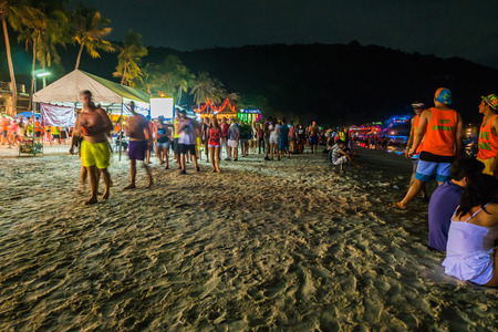 burns night: Koh Phangan, Thailand - October 8, 2014: The Full moon party at Haad Rin, Koh Phangan, Thailand. The Full Moon Party is an all-night beach party that originated in Haad Rin on the island of Ko Pha Ngan, Thailand on the night of, before or after every full Editorial