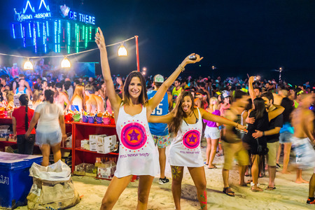 Koh Phangan, Thailand - October 8, 2014: The Full moon party at Haad Rin, Koh Phangan, Thailand. The Full Moon Party is an all-night beach party that originated in Haad Rin on the island of Ko Pha Ngan, Thailand on the night of, before or after every full Editoriali