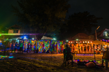 Koh Phangan, Thailand - October 8, 2014: The Full moon party at Haad Rin, Koh Phangan, Thailand. The Full Moon Party is an all-night beach party that originated in Haad Rin on the island of Ko Pha Ngan, Thailand on the night of, before or after every full Publikacyjne