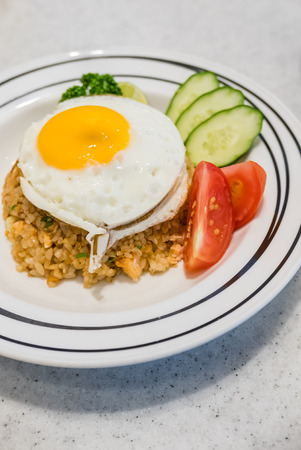 Japanese style Fried rice tuna with topped egg. Stock Photo
