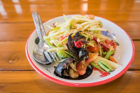 peppery: Mango salad or Som Tam Mango, Thai delicious green Mango salad taste hot and spicy