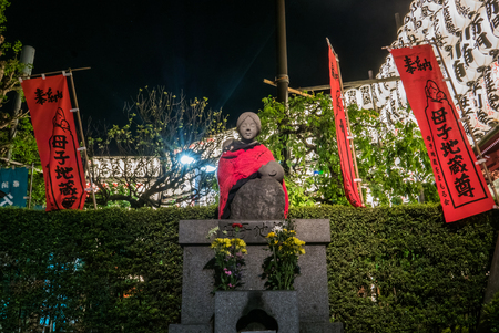 senso ji: Tokyo, Japan - April 30, 2016: Statue of mother and children in Tokyo, Japan. In Sensoji temple area, its built to comfort spirits of mothers and children in Manchuria towards the end of WW II.