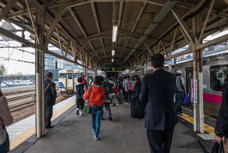 jointly: Aomori, Japan - April 30, 2016: Passengers at Hirosaki Station, Hirosaki Station is a railway station in the city of Hirosaki, Aomori Prefecture, Japan, jointly operated by East Japan Railway Company (JR East) and the private railway operator Kōnan Railw Editorial