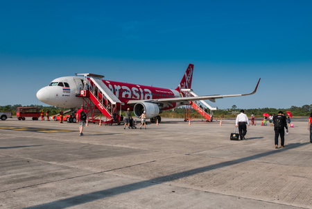 Nakhon Si Thammarat, Thailand - April 27, 2016: AirAsia airplane in Nakhon Si Thammarat airport in Nakhon Si Thammarat province, Thailand. Its been named as worlds best low-cost airline, operates scheduled flights to 78 destinations